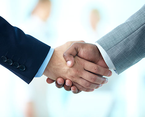 Shaking hands for a successful job in his business formation in Columbus, OH.